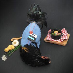 Chapon effilé et plumage à sec dans sa parure de Noël